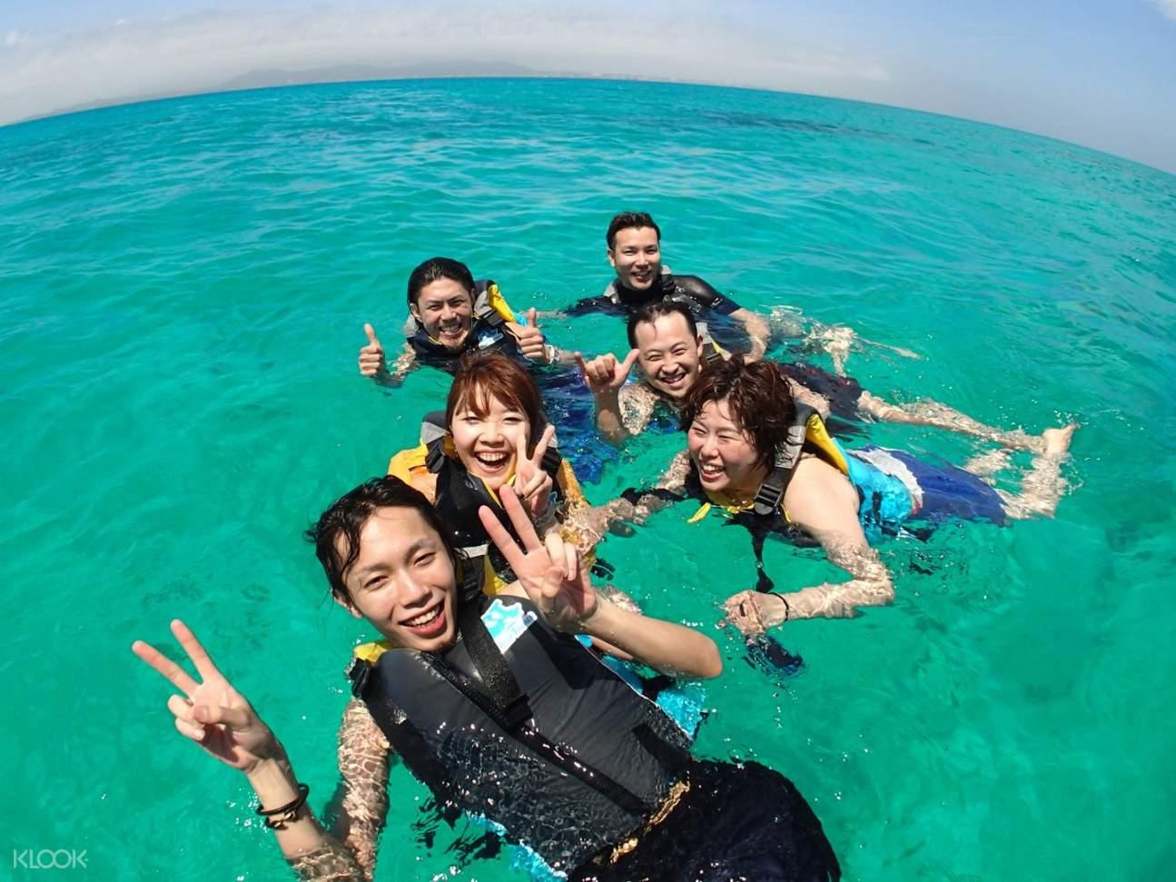 friends snorkeling in phantom island