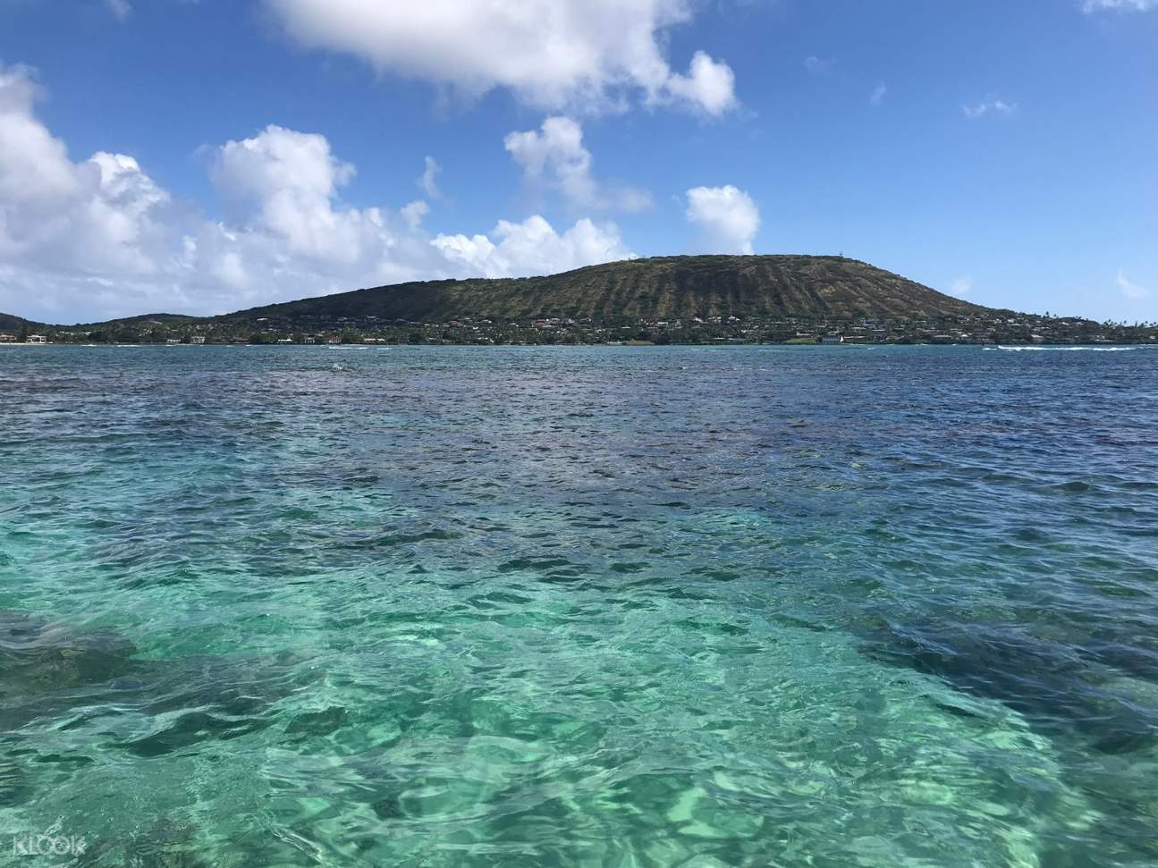 a view of Maunalua Bay's crystal clear waters and a crater