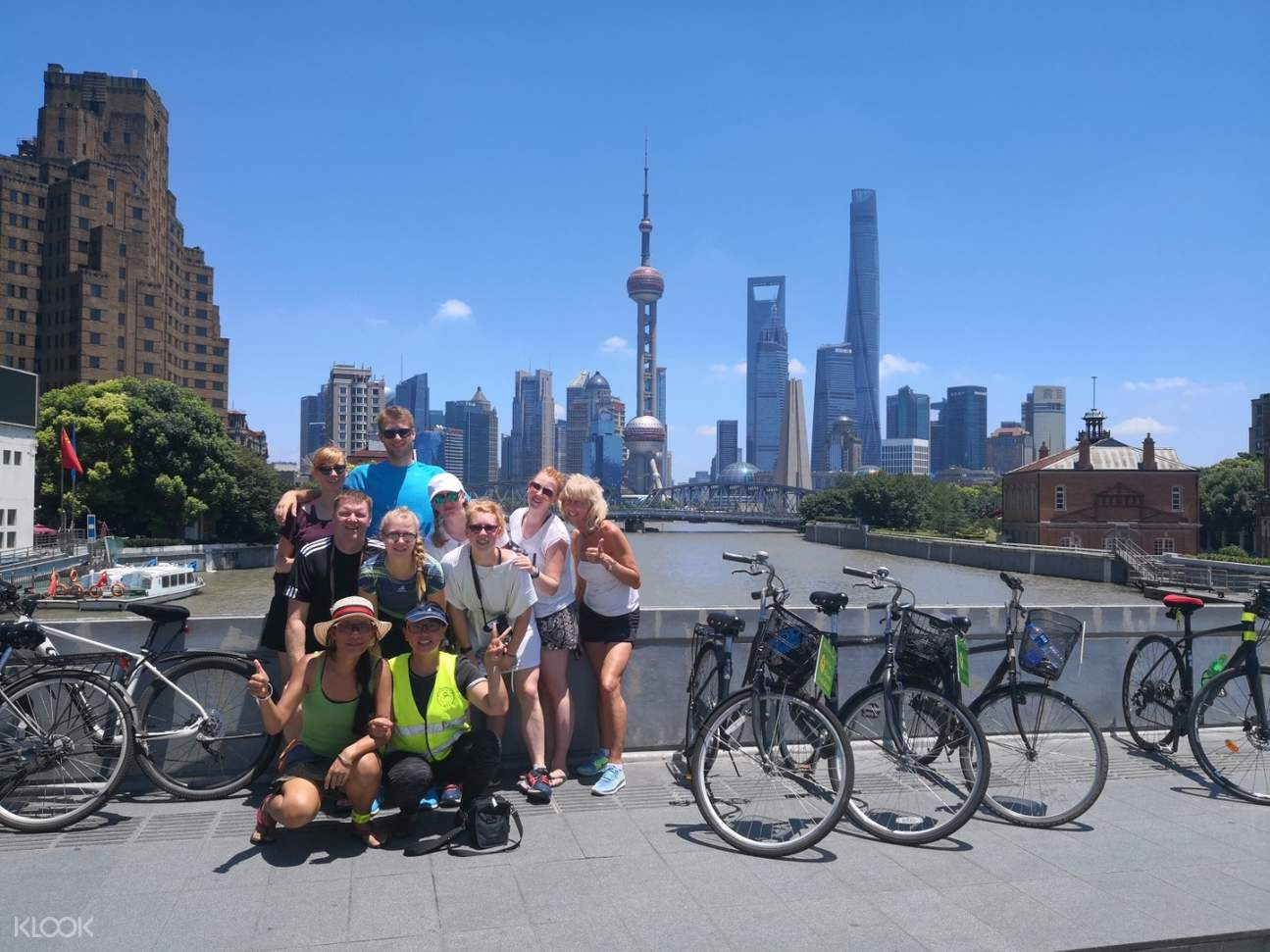 bikers with the bund as the background