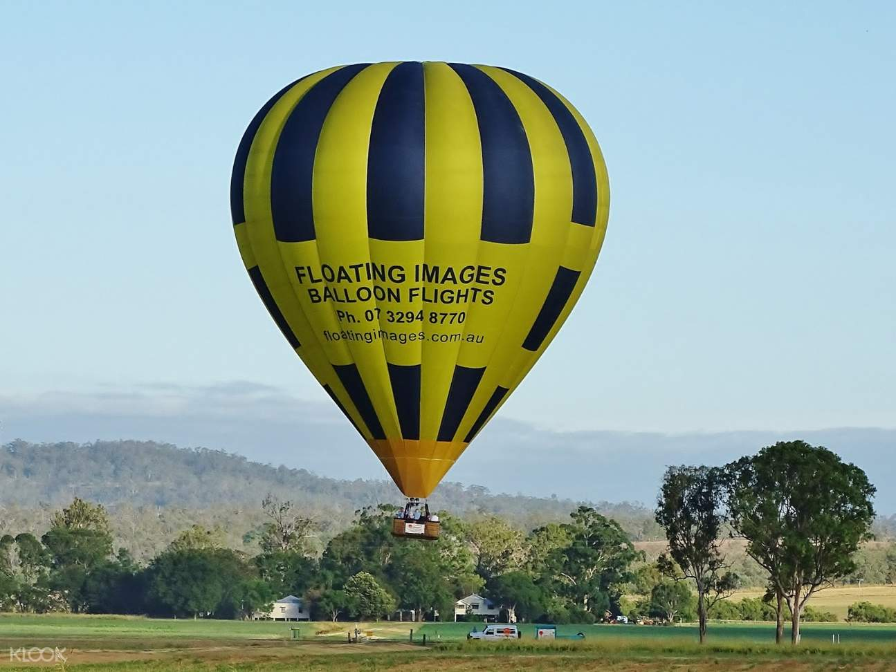 hot air balloon slowly lifting off grounds