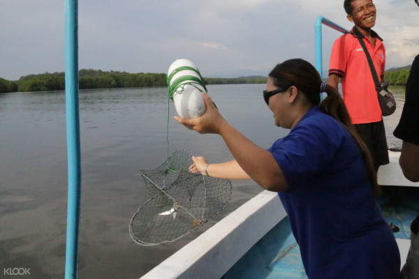 Learn how to fish at Sapi Island Full Day Tour and River Cruise