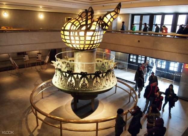lantern statue inside the statue of liberty museum