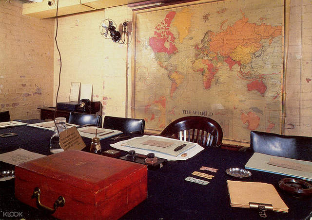 tables, chares, and map inside the churchill war rooms