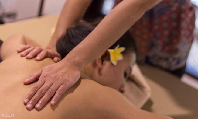 a woman having back massage
