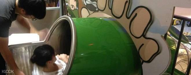 kid on the gigantic slide