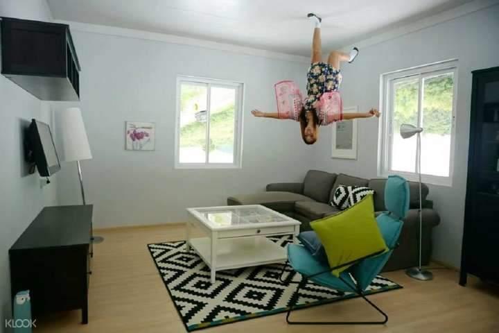 Woman in upside down bedroom