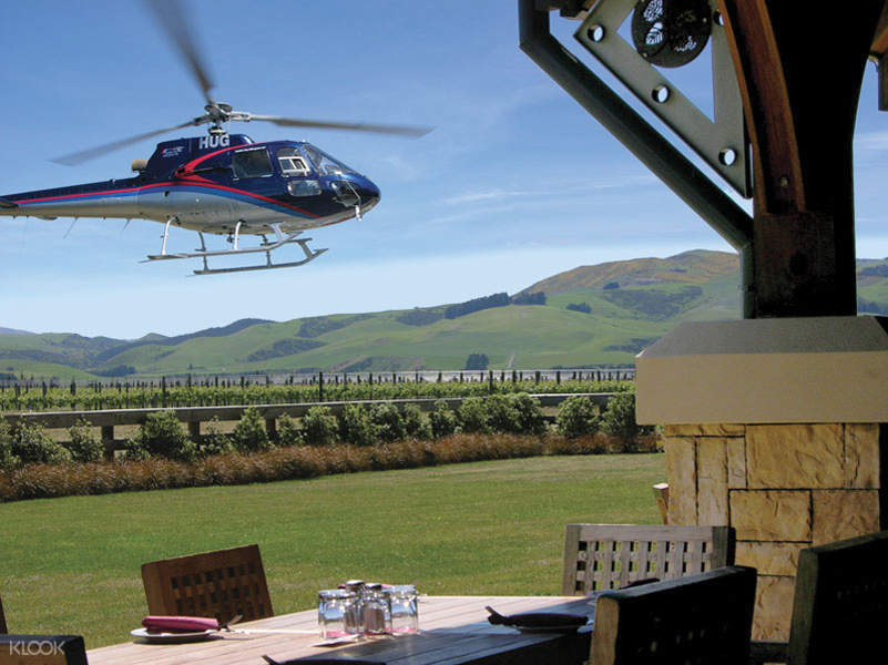 a helicopter near a table with wine glasses