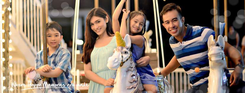 family riding a carousel at sky ranch tagaytay