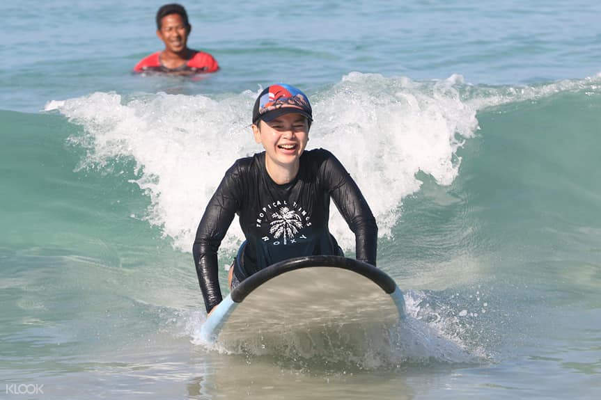 person learning how to surf
