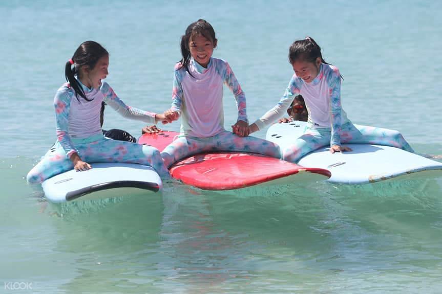 three girls on board surfing