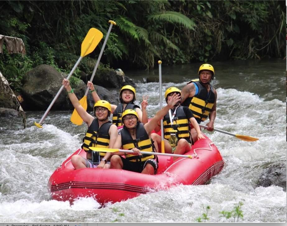 visitors enjoying rafting in bali