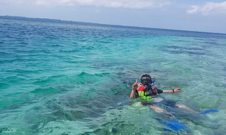 person snorkeling around Pulau Kentut