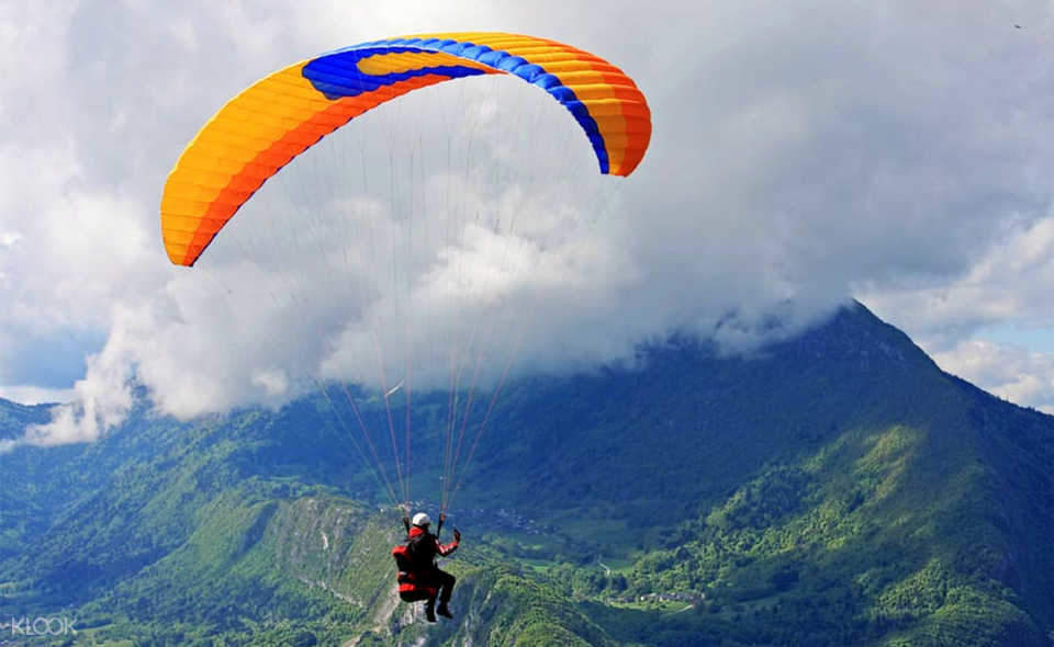 mountains and paraglider