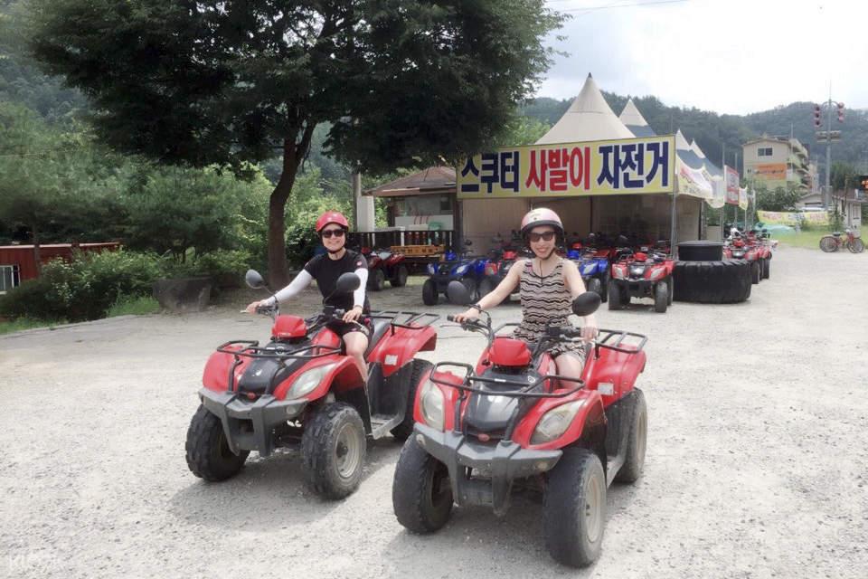 couple on ATV bikes