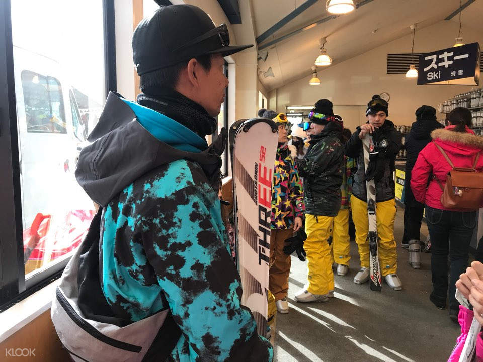 Skiers putting on suits