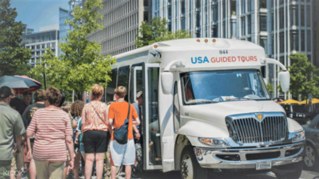 people boarding the USA Guided Tours bus
