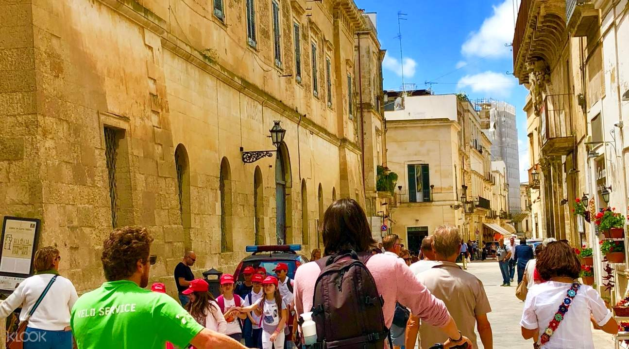 people walking in street of lecce